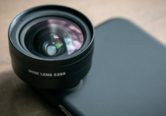 What is a telephoto lens used for